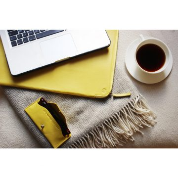 Yellow Folio Laptop Sleeve And Soft Glasses Case Lifestyle